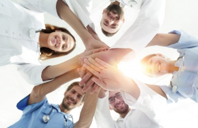 group of nurses joining hands