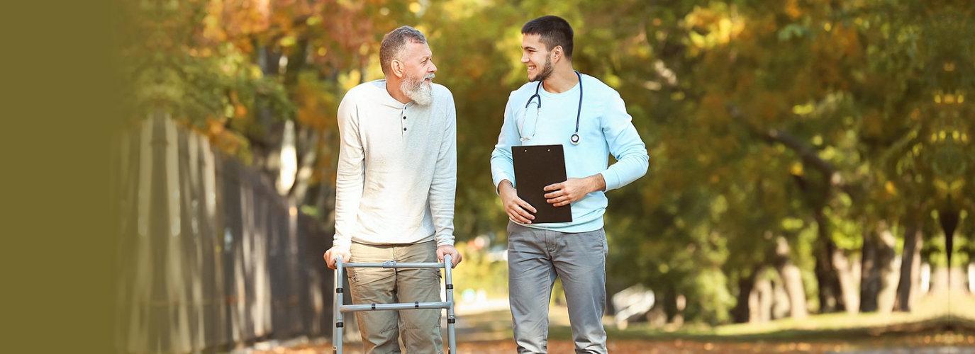 nurse walking with his patient